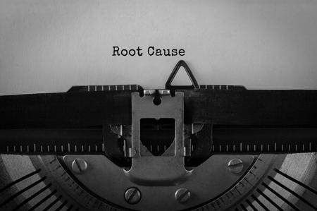 Text Root Cause typed on retro typewriter