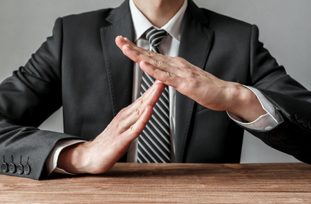 Businessman showing time-out gesture, body language,business concept