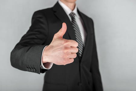 Closeup of businessman showing thumbs up. Business concept. Stockfoto