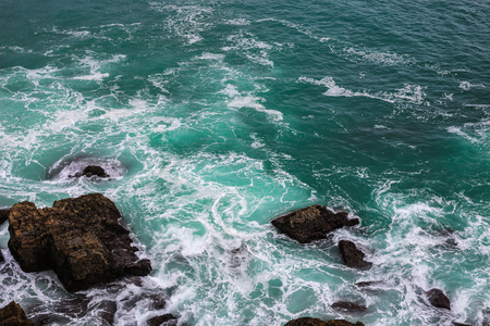 Ocean wave. High angle view to ocean waves. Blue water background.
