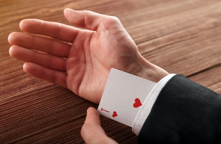 Business man with ace in his sleeve. Stockfoto