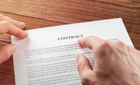 Close up of businessman reading contract. Concept