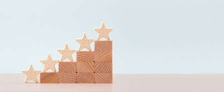 Wooden five star shape on table. Concept of increase rating, ranking, evaluation and classification idea