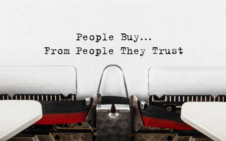 Text People Buy From People They Trust typed on retro typewriter.