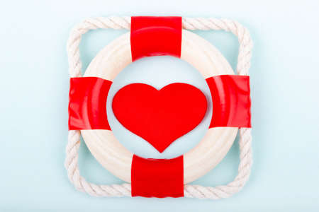 Red heart in lifebuoy. Health insurance concept.