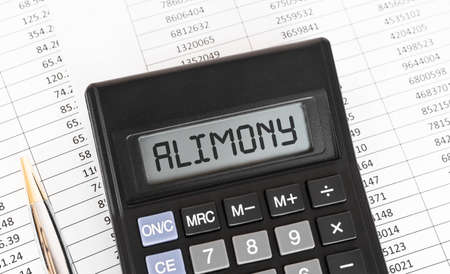 Calculator with the word alimony on the display. Standard-Bild