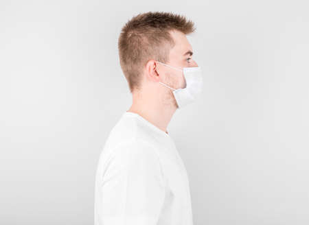 Man wearing hygienic mask to prevent infection, airborne respiratory illness such as flu, 2019-nCoV. indoor isolated on white background.
