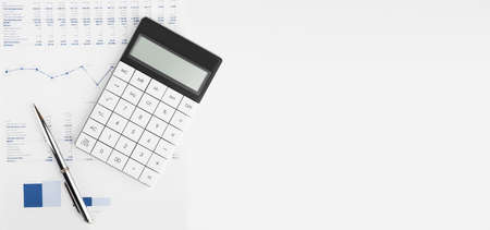 Calculator on financial statement and balance sheeet on desk of auditor. Concept of accounting and audit business. Stock Photo