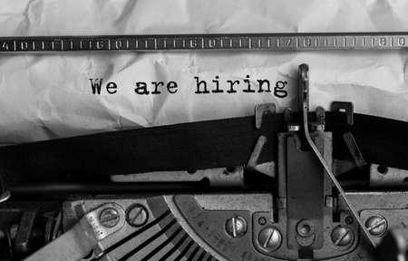 Text We are hiring typed on retro typewriter Stock Photo