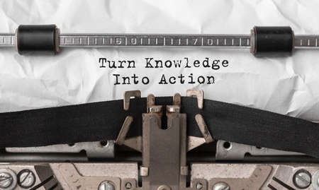 Text Turn Knowledge Into Action typed on retro typewriter