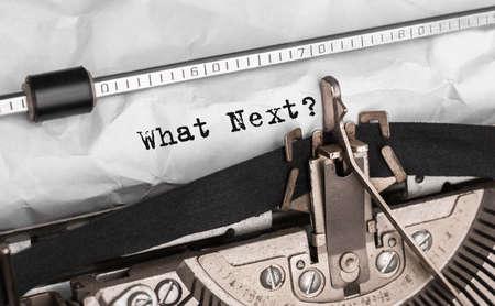 Text What Next typed on retro typewriter Stock Photo