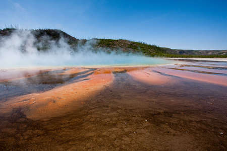 A mosaic of colors created by water rich in bacteria, minerals, and algae at Grand Prismatic Spring in Yellowstone. Stok Fotoğraf