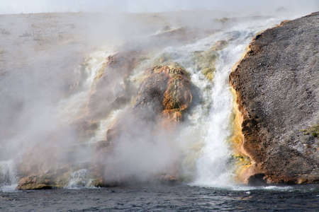 gallons: Runoff from Excelsior Geyser pours into the Firehole river at more than 4000 gallons per minute. Stock Photo
