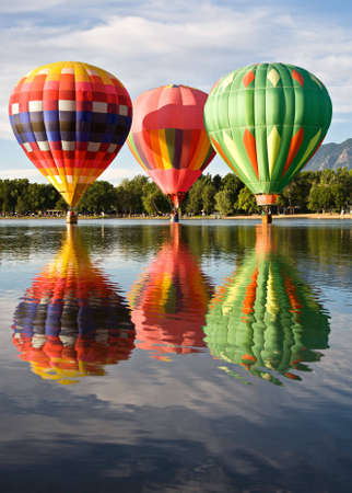 departing: Three pilots get a little wet before departing Memorial Park during the Colorado Springs Balloon Classic.