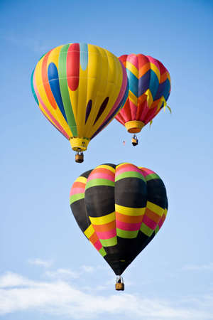 cloud drift: Three colorful balloons ascend in the sky above Colorado Springs Balloon Classic. Stock Photo