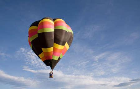 drifts: A solitary balloon drifts through the morning sky above Colorado Springs Balloon Classic. Stock Photo