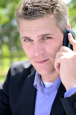 consciously: young businessman with mobilphone