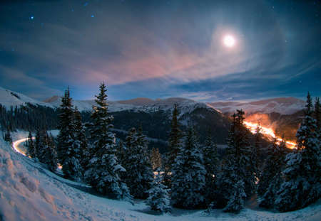 This long-exposure image was taken from Loveland Pass west of Georgetown, Colorado on a really cold night - right after the pass re-opened from a winter storm closure. photo