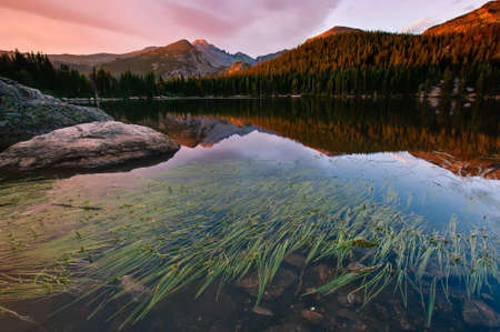 Beautiful morning light hits Longs Peak, Glacier Gorge, and the peaks of Rocky Mountain National Park.  This image was taken from Bear Lake near the town of Estes Park, Colorado - right before some breezy weather blew in and ruined the reflection.