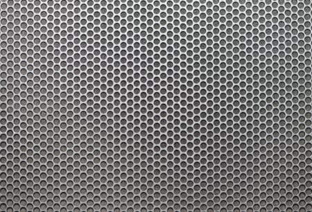 Sheet of metal covered circular holes