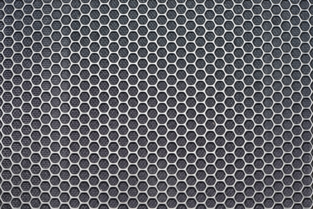 Sheet metal with lines of round holes photo