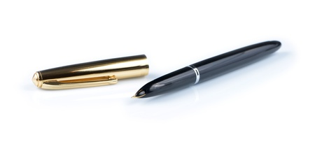 Golden ink pen isolated on white background photo