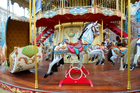 Children carousel running horses