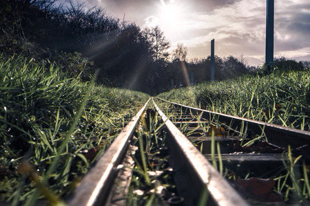 minature: Train tracks on a model railway, Belhus woods in Essex, UK Stock Photo