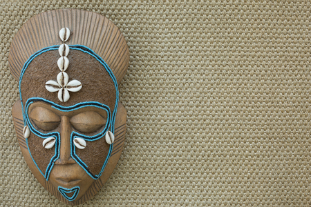 African mask hanging on wall