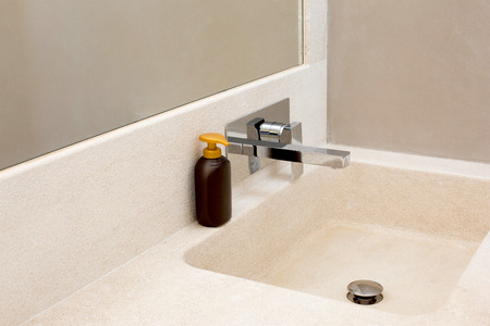 granite bathroom sink with hand soap