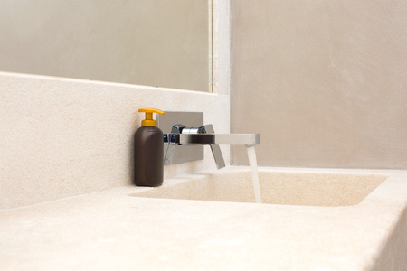 tap room: granite bathroom sink with hand soap