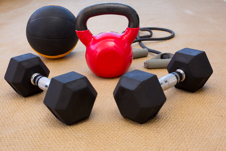 gym floor: workout equiptment on gym floor Stock Photo