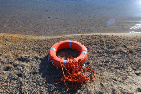 beach buoy: A lifeguard buoy with rope on a beach in Italy Stock Photo