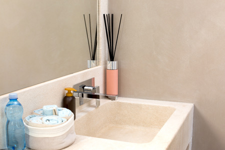 spa bathroom with bottle water, hand towels, hand soap and scented sticks