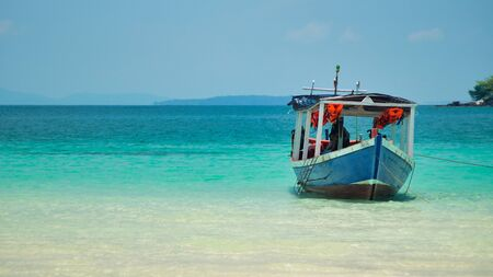 A boat near shore of Koh Ring Island Cambodia