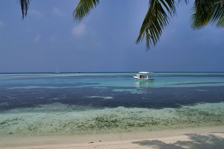 View on boat on Picnic Island near Maafushi Island Maldives