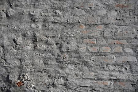 Old vintage cracked bricks with concrete texture. 写真素材