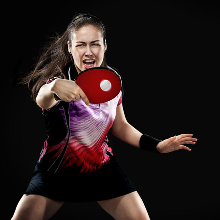 Portrait Of Young Girl Playing Tennis On Black Background