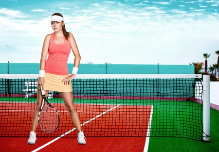 dross: Full length portrait of a young woman on a tennis  dross field Stock Photo