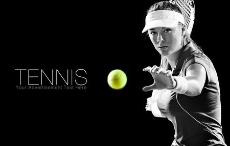 Portrait of beautiful girl tennis player with a racket isolated on black background Stockfoto