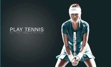 Portrait of beautiful girl tennis player with a racket isolated on dark background 스톡 콘텐츠