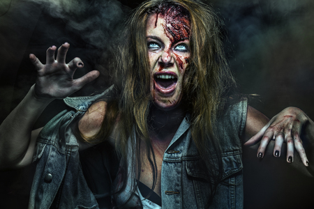 Scary zombie woman with wounds.