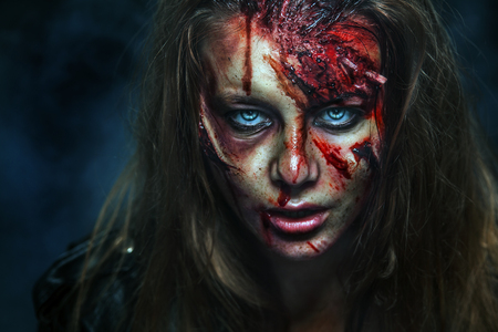 horror: Scary zombie woman with wounds.