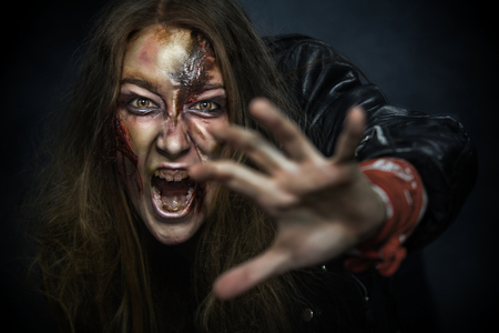 face zombie: Scary zombie woman with wounds.