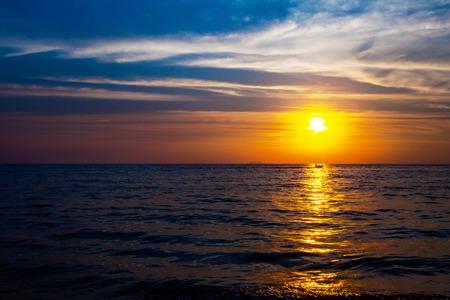 jetski: Drifting jetski in the sea on a sunset Stock Photo