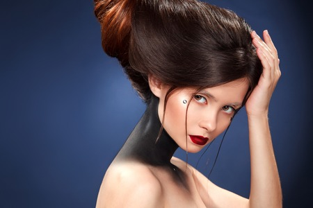 daemon: Beautiful girl with a haird in the form of horns. Ads for hairdressers.