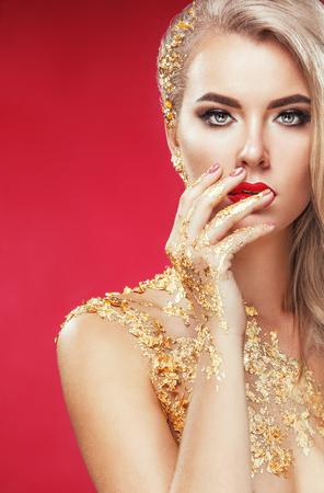 Golden Plated Womans Face. Art makeup.