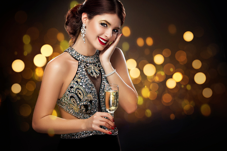 Woman in evening dress with champagne glasses - St valentines day celebration. Party. New Year and Chrismtas Foto de archivo