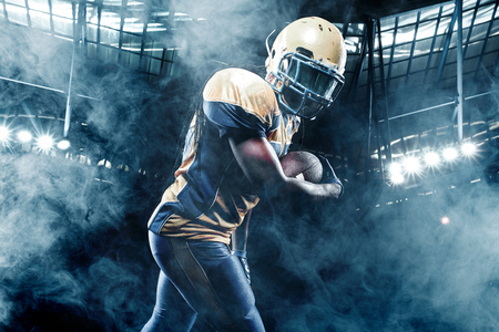 American football sportsman player on stadium running in action