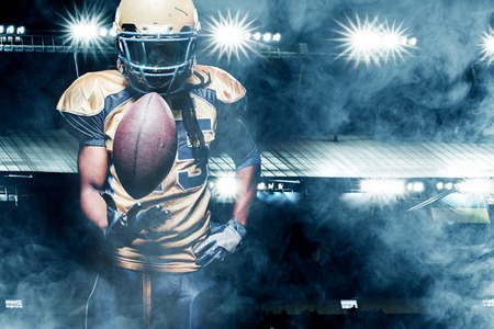American football sportsman player on stadium running in action Stock fotó - 75798049